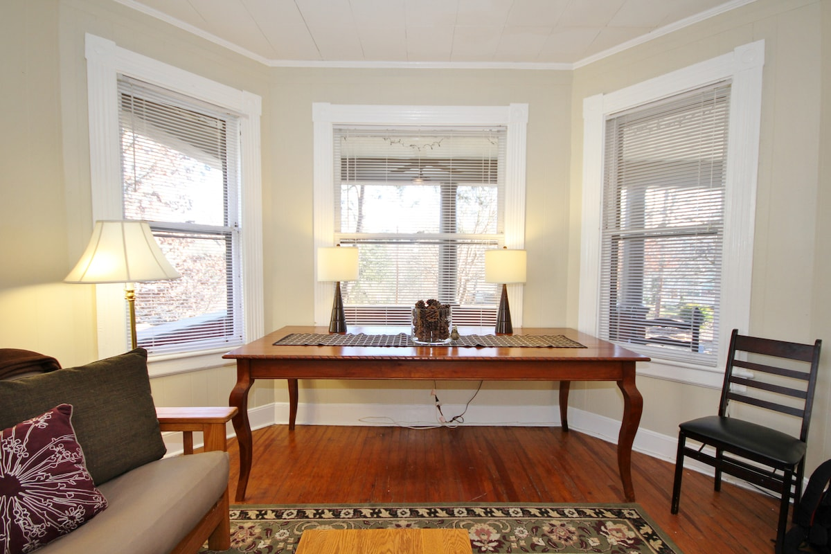 This large cherry table is loved by writers. They enjoy working in the natural light with tall hemlocks in view.