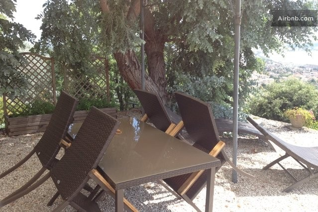 Outside private terrace with table and chairs