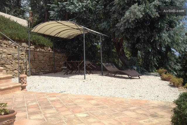 Terrace with pergola and sunbathing chairs