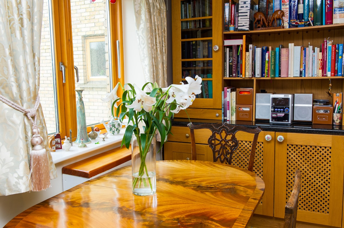 Our dining table with window sill pottery by Radek