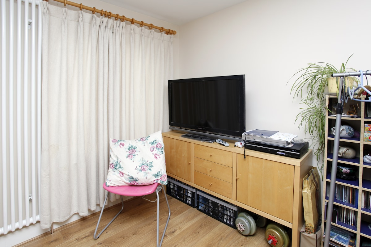 Living room with 42 inch LCD TV, shared with the host and other guests.