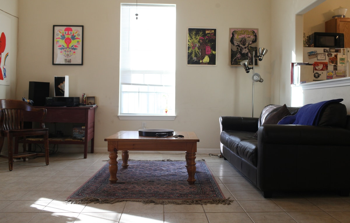 Living room with stereo system and mounted wall speakers