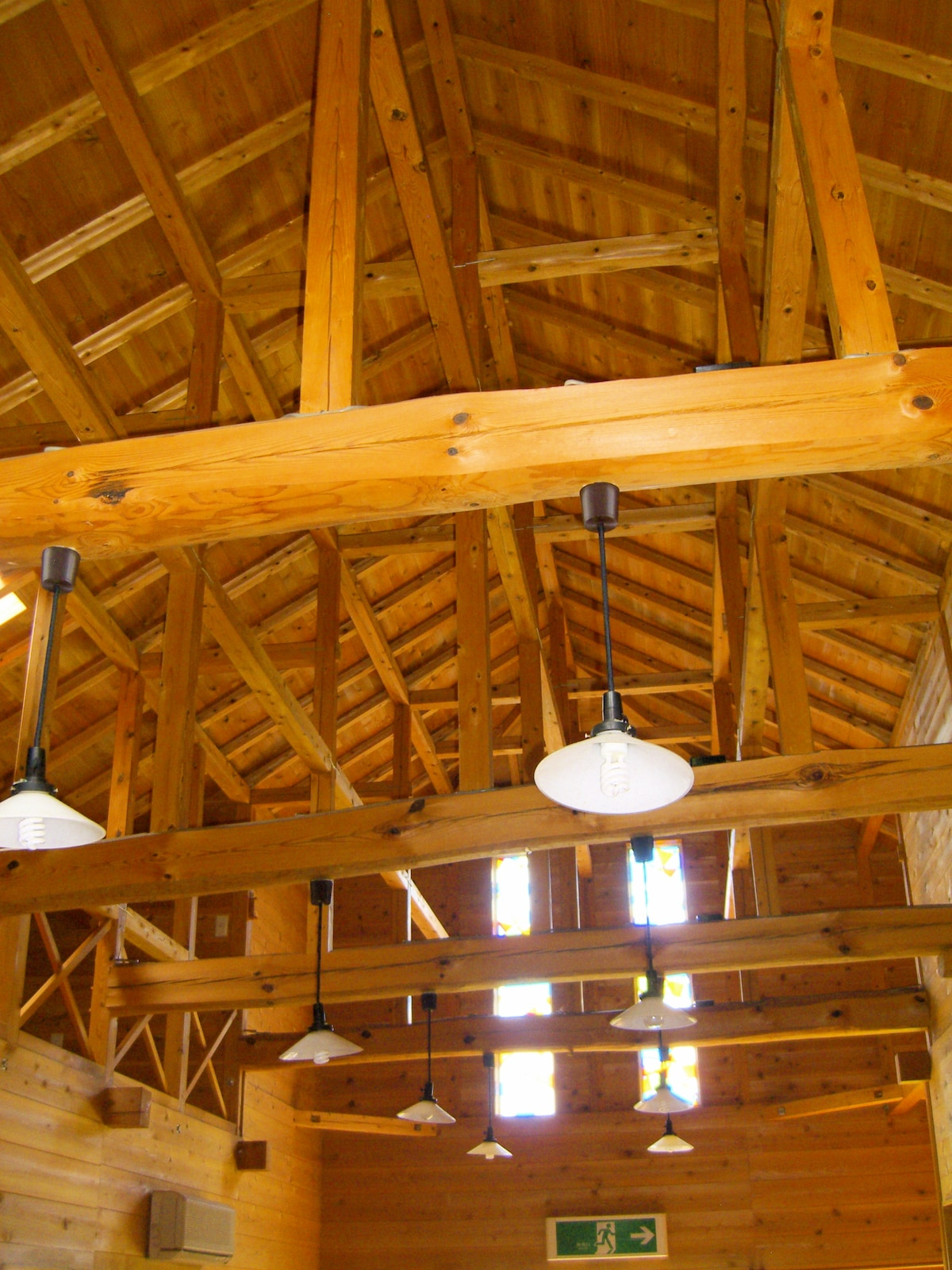 The main inn's hand-carved beams evoke historical Japanese architecture.