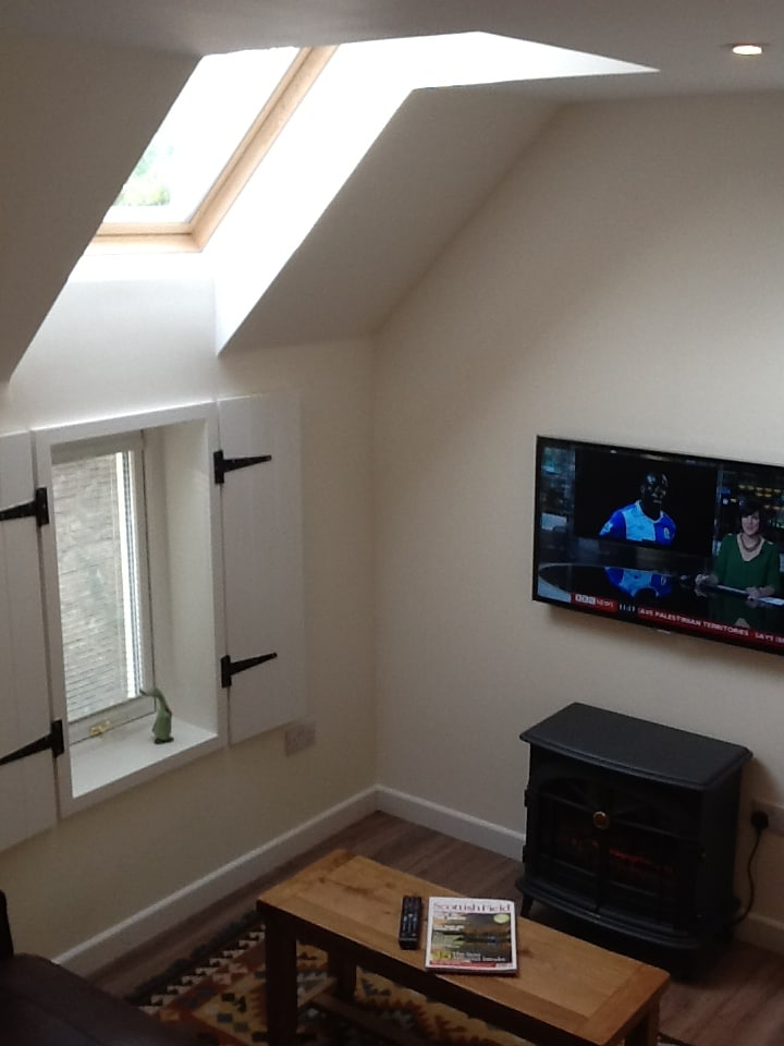 The living area, complete with lots of natural light provided by extended skylight window