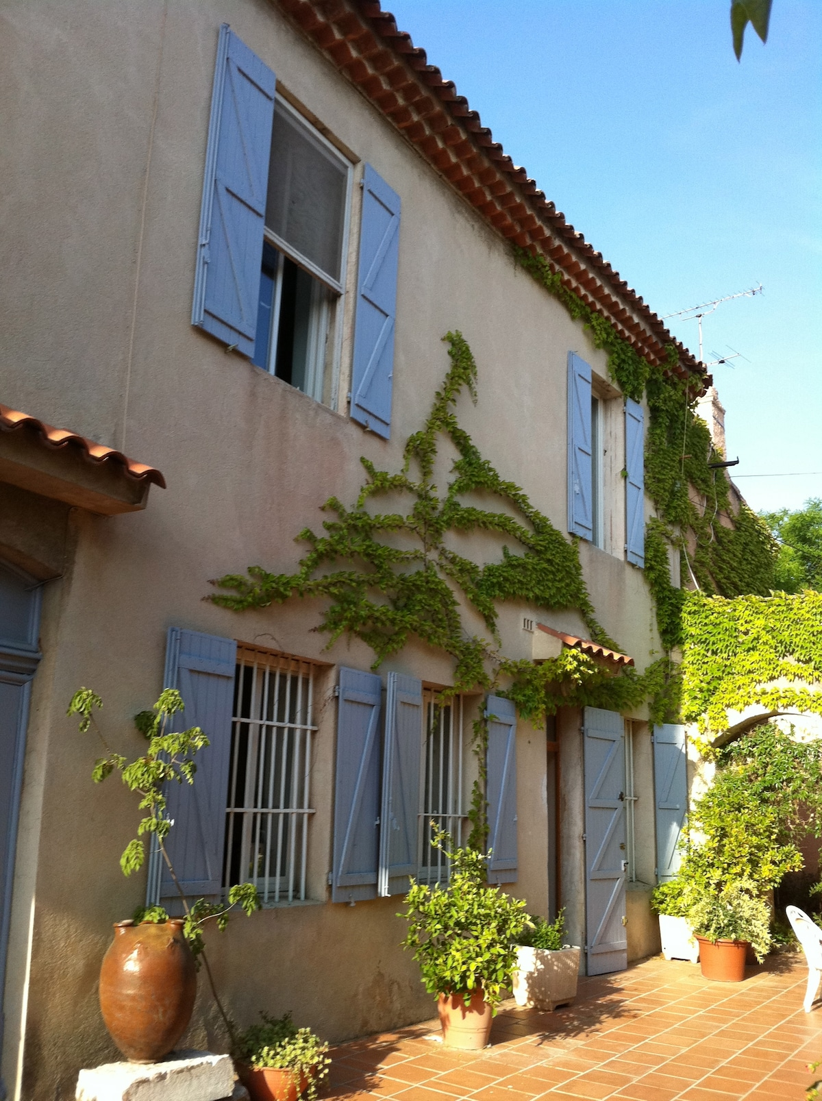Early summer, the facade of a traditional bastide in Provence