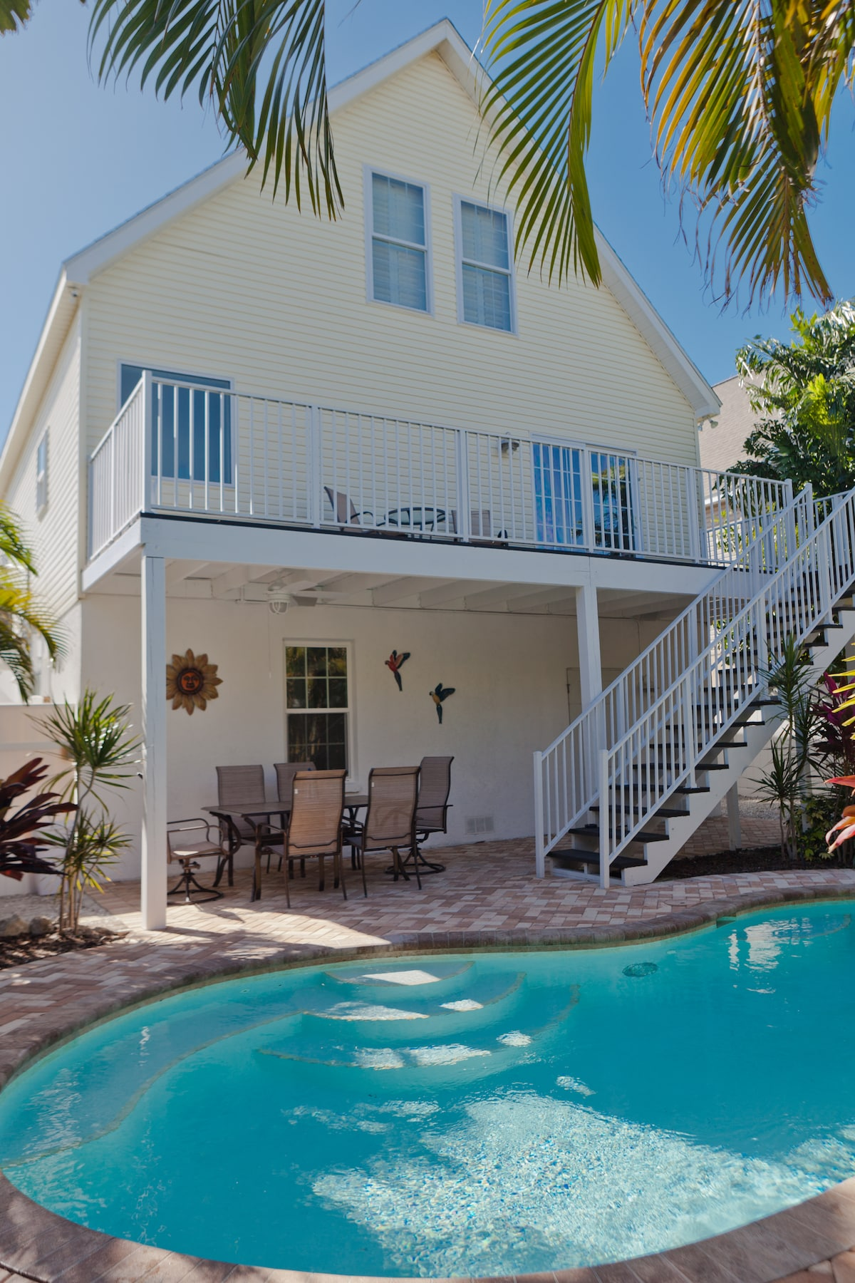 Private heated pool and a spacious seating area with an outdoor table set for 6