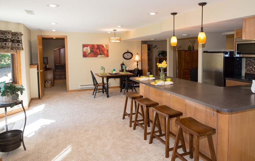 Open Concept kitchen, dinning and living room - straight ahead is the bedroom and to the left is your private keyed entrance