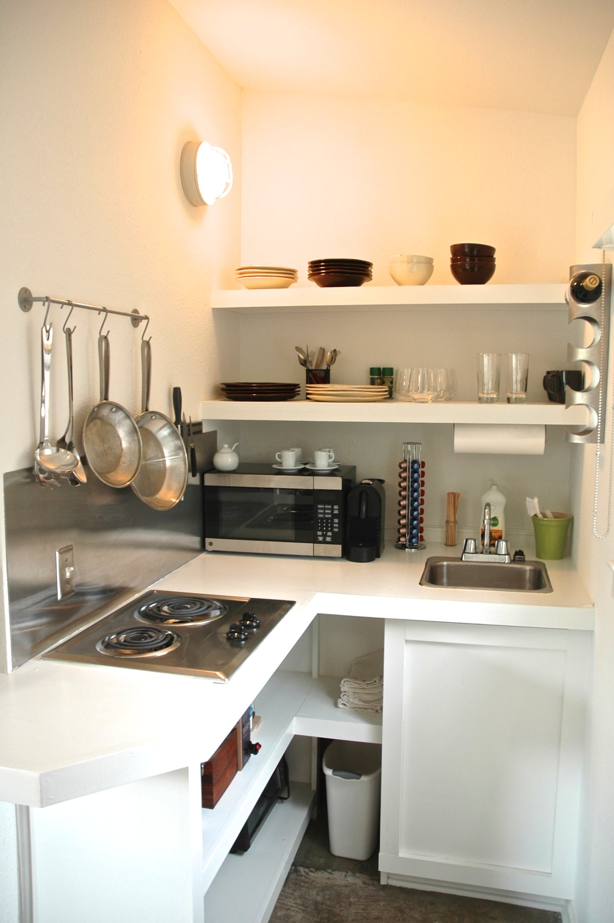 Kitchenette has a stove, microwave, Nespresso machine, and hand-made Italian dinnerware.