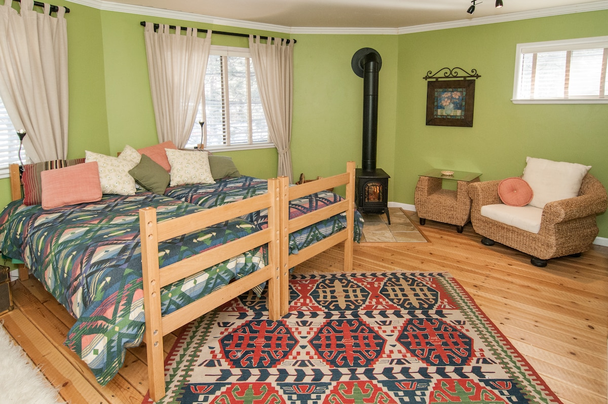 Large room with wood stove and 4 new beds.