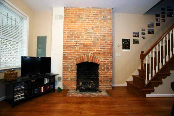 The former coal-burning fireplace that was used in the early 1900s has been converted to a gas fireplace.