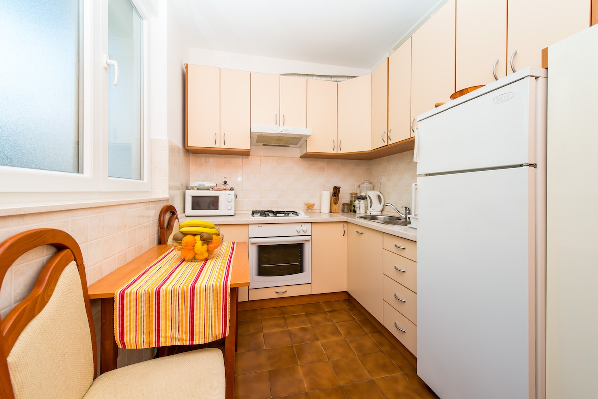 Fully equipped kitchen with microwave, oven, kettle, coffee machine, toaster