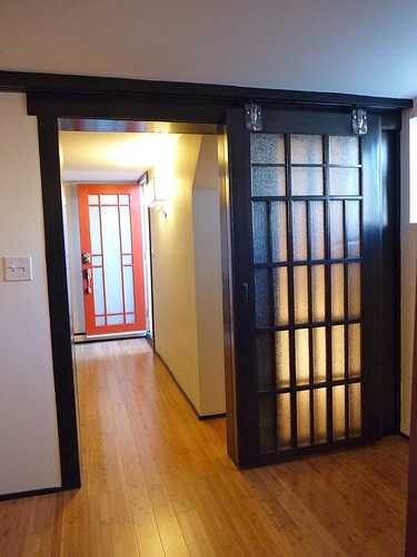 Refurbished Japanese shoji sliding doors add light and style from the bedroom.