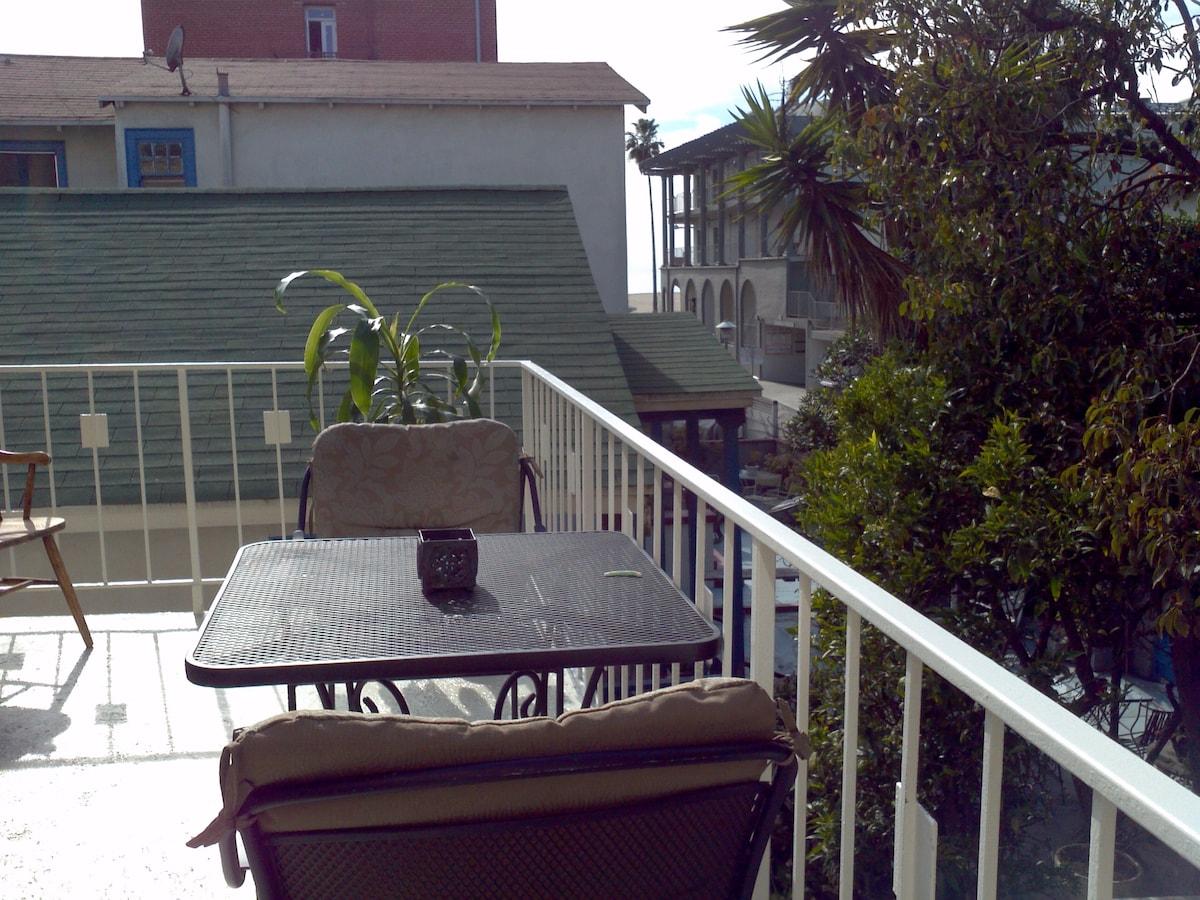 Semi private patio with peak of the ocean