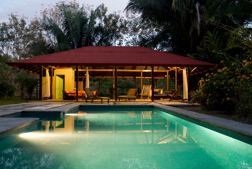 private saltwater pool/pool house at night