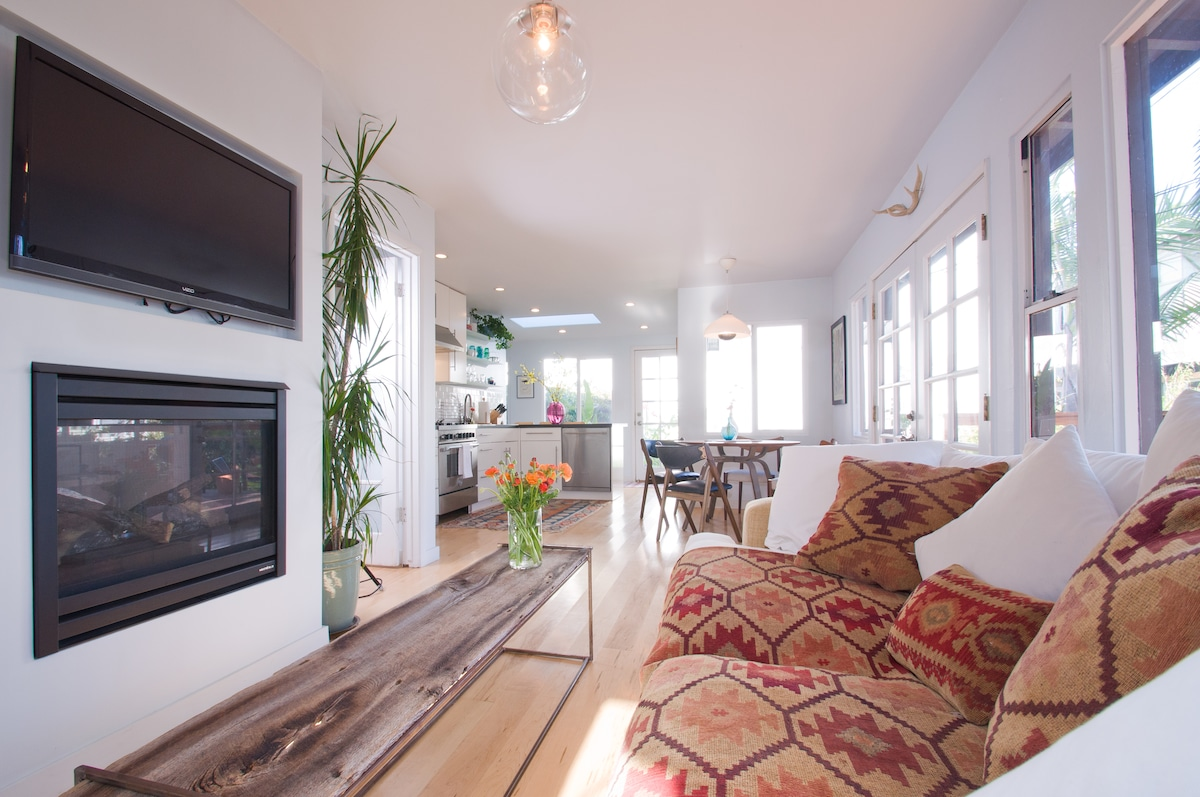 The main living space boasts a double sided gas fire place and cable television.