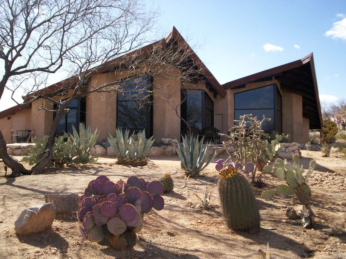 Exterior of home with floor to ceiling windows enhancing views of majestic Catalina Mountains!