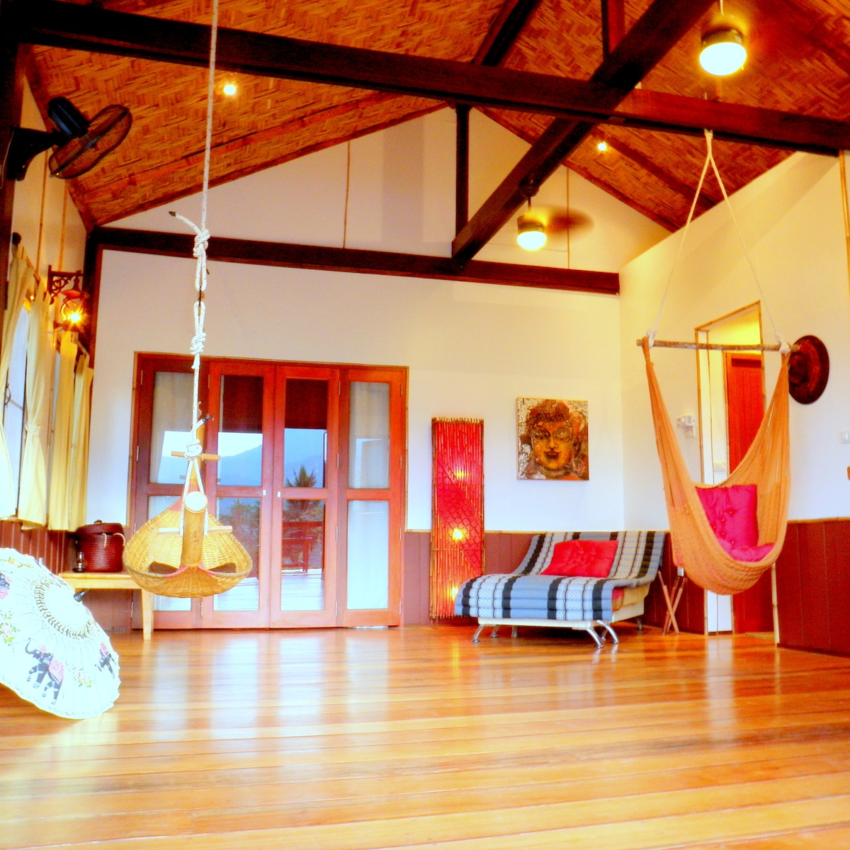 Comfortable lounge and hammocks atmosphere. Local, rustic, hand-crafted artisan living space