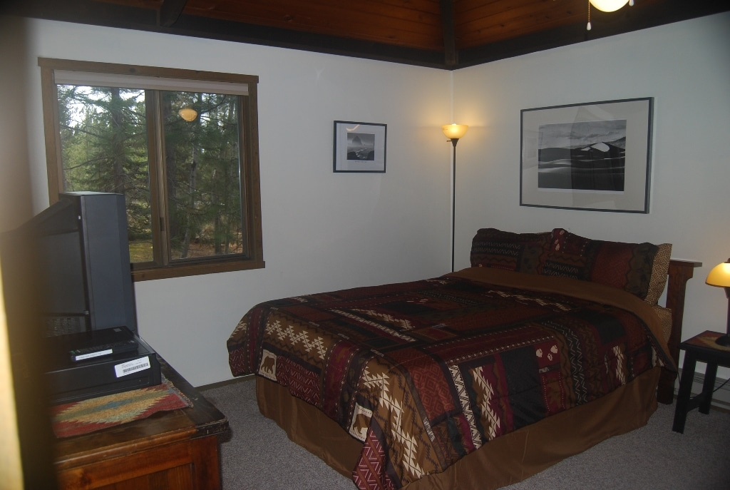Master bedroom with new queen memory foam mattress, CATV w/ DVD player, portable crib and master bath.