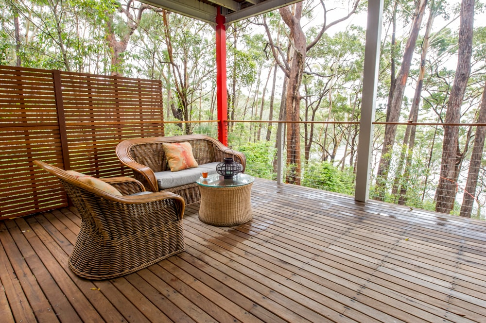 Large and comfortable veranda with the views of the trees and the lake