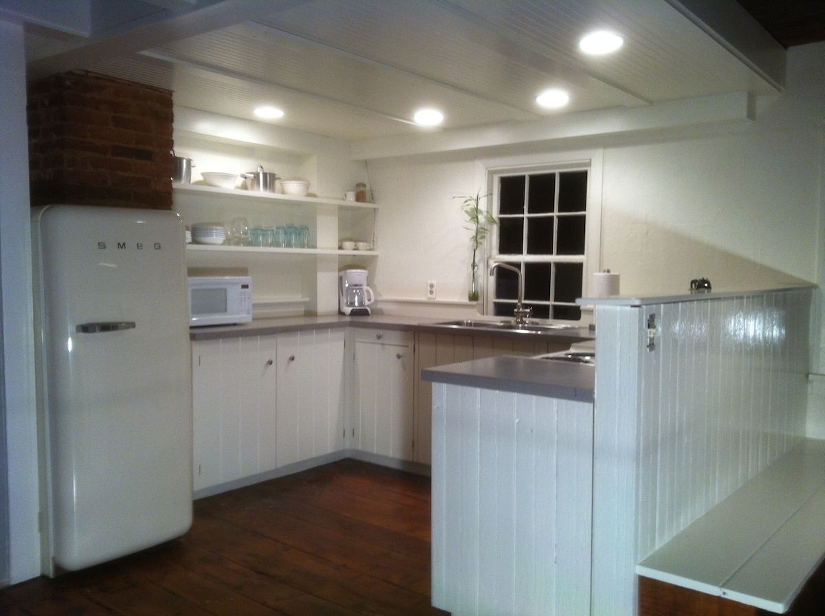 Your full kitchen with modern amenities, new appliances, and updated, original cabinets, windows and wide-plank hardwood floors.