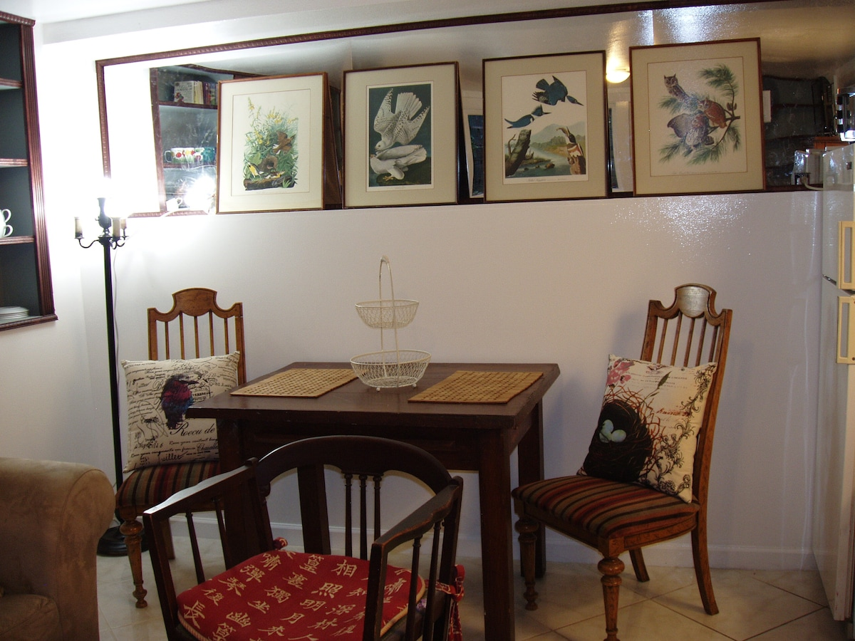 Dining area with electrical outlet for use as a desk