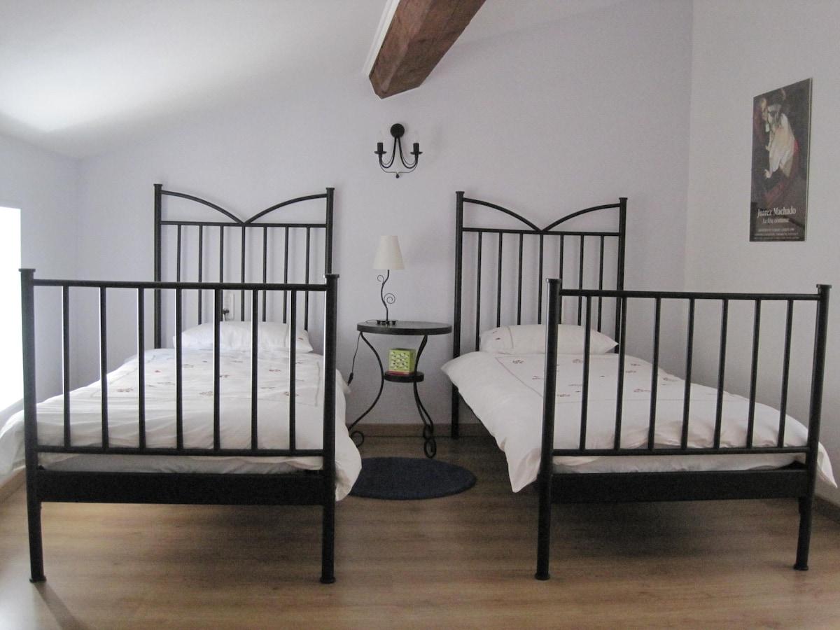 Bedroom 2 with three single beds and en-suite bathroom