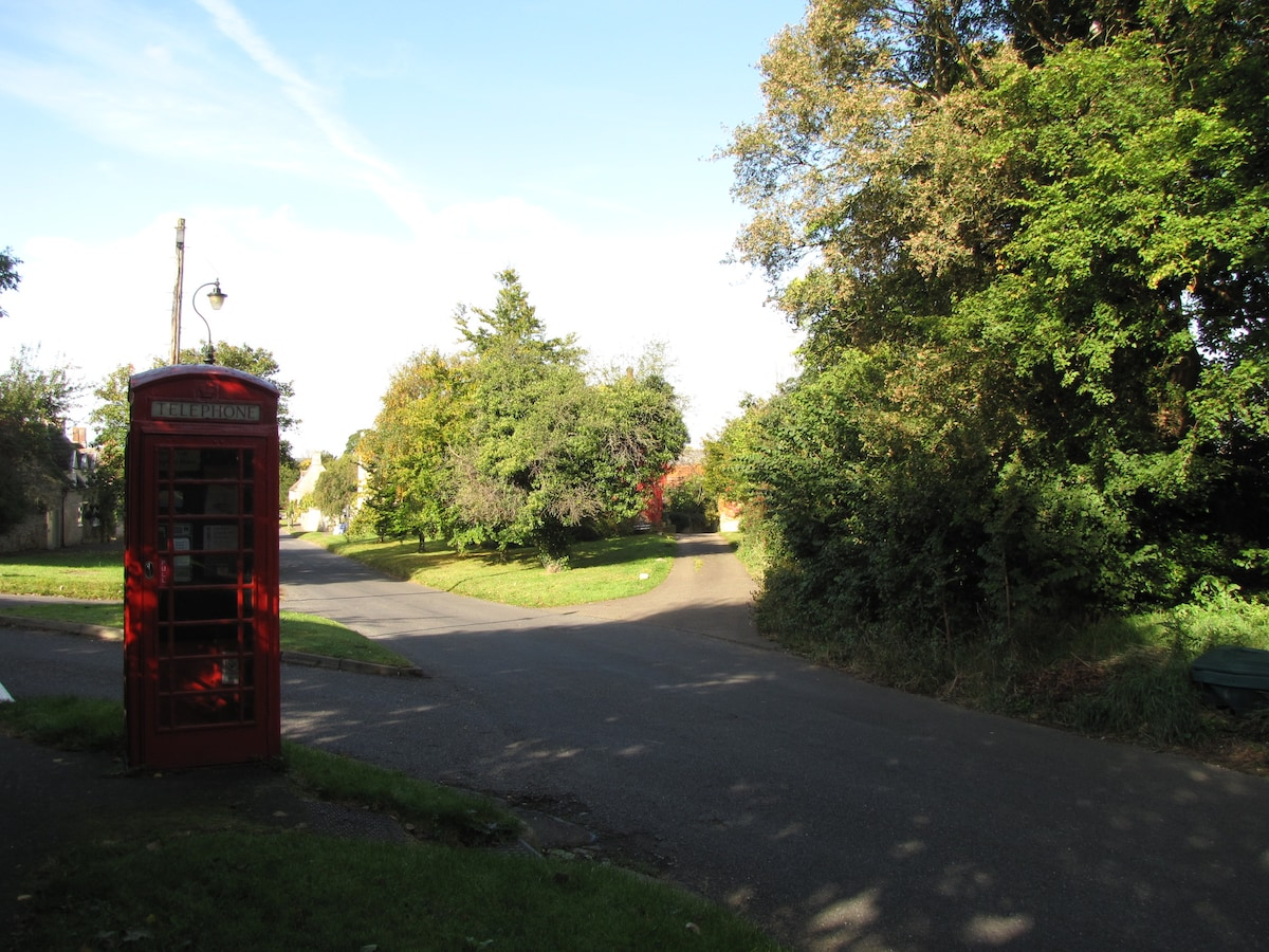Access road to Mews, turn 45 degrees right at red phone box