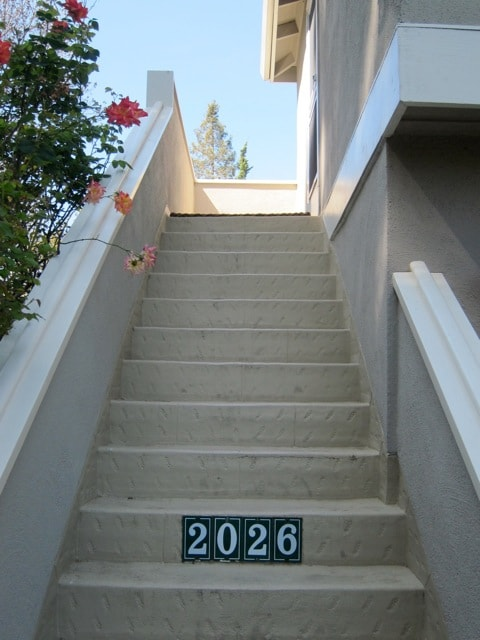 Stairs leading to the entrance door of the studio