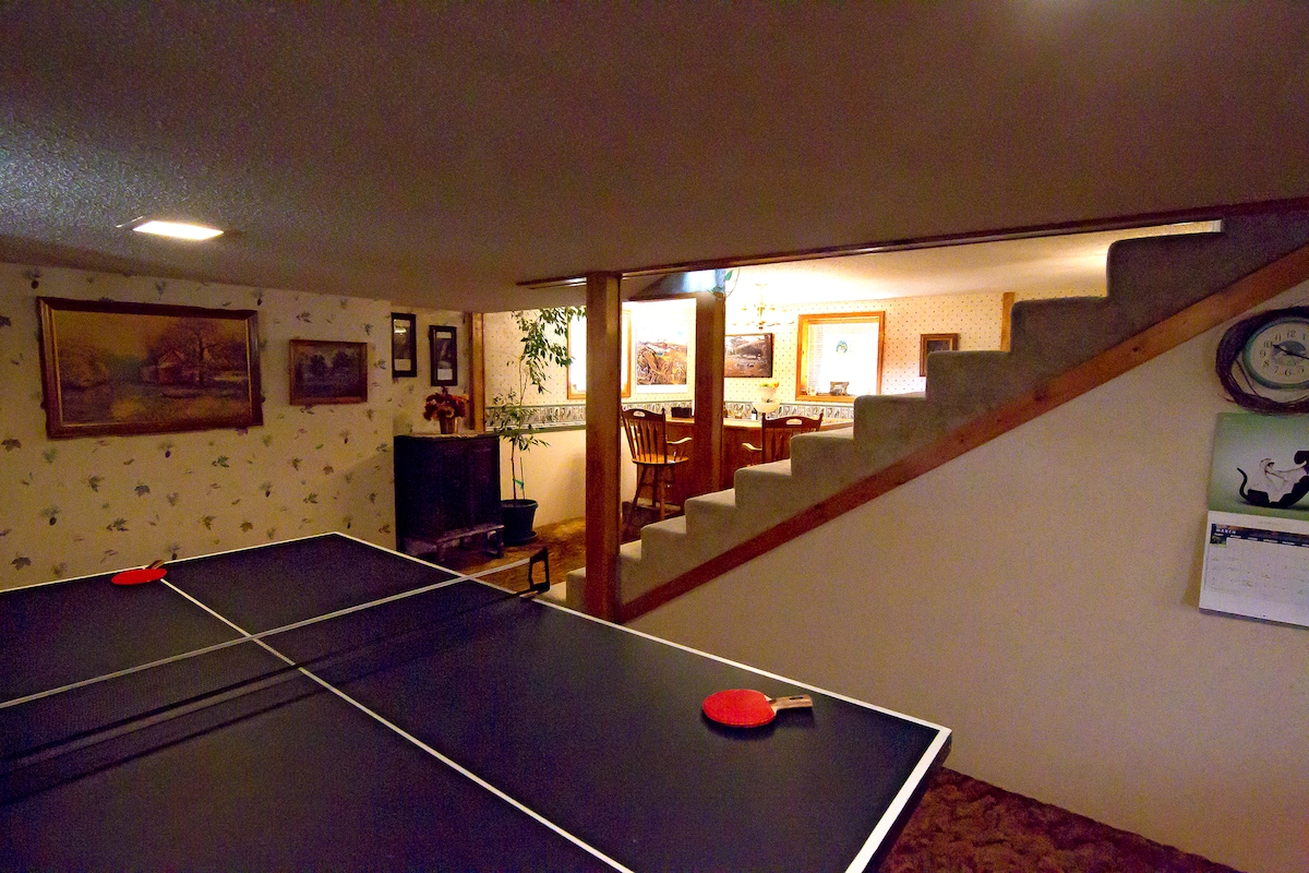 Looking from the table-tennis room toward the bar/lounge area - Yellowstone Country Suite