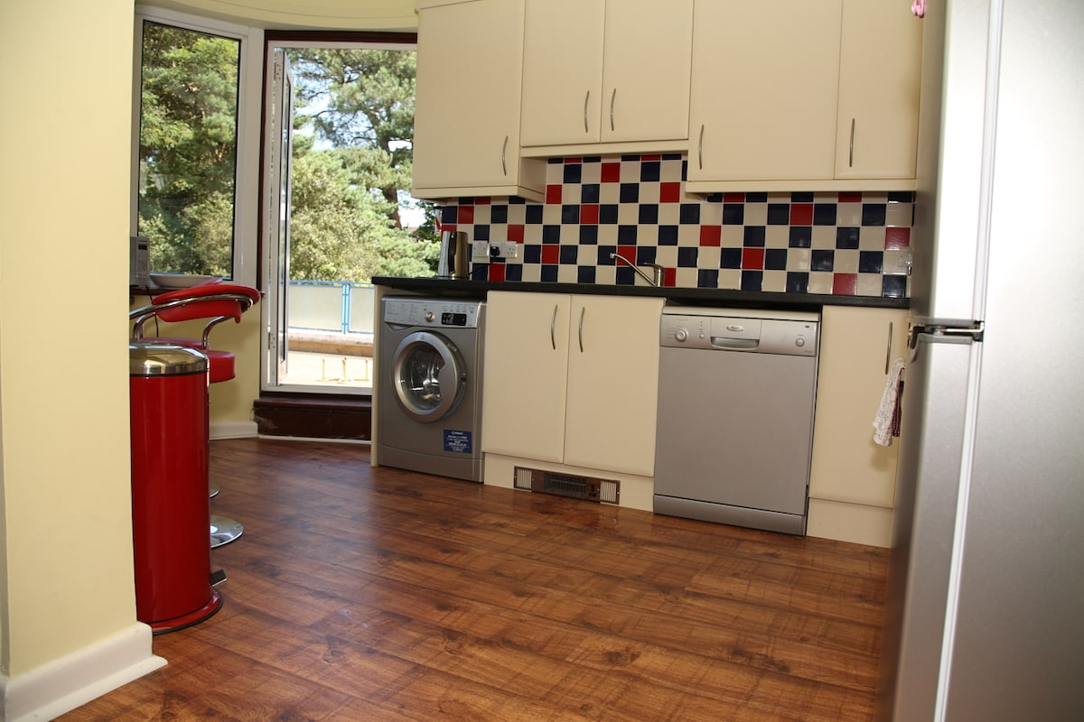 The bright fully fitted kitchen opening on to the balcony