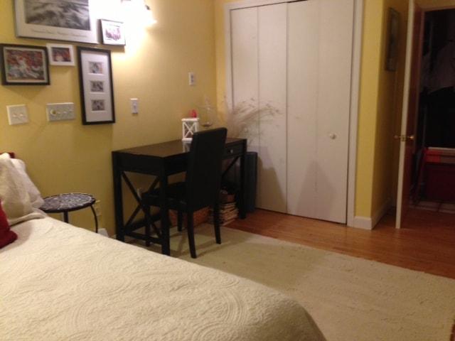 Private bedrrom has a desk and closet
