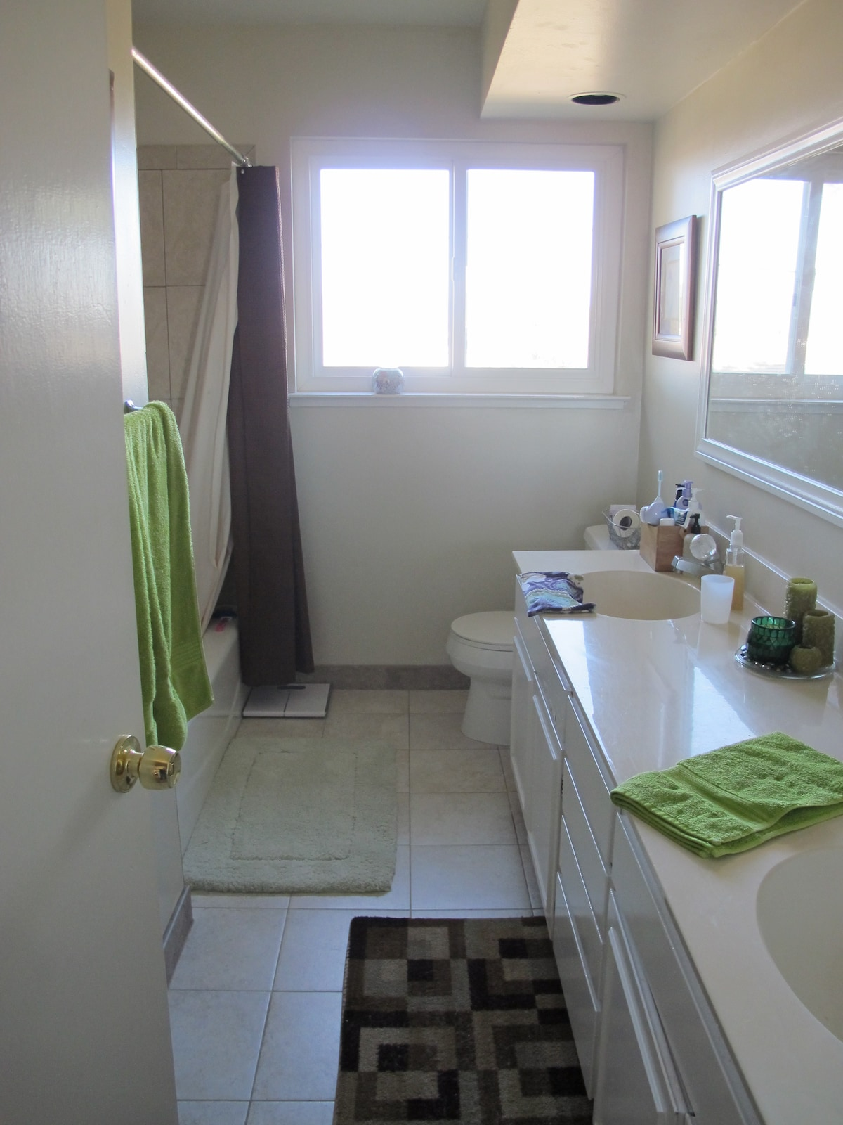 Shared bathroom with dual sinks. The sink closest to the door is your private sink.