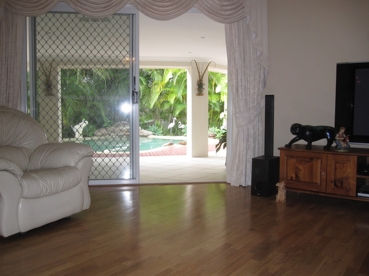 Relax in the lounge room with massive flat screen and cable TV.
