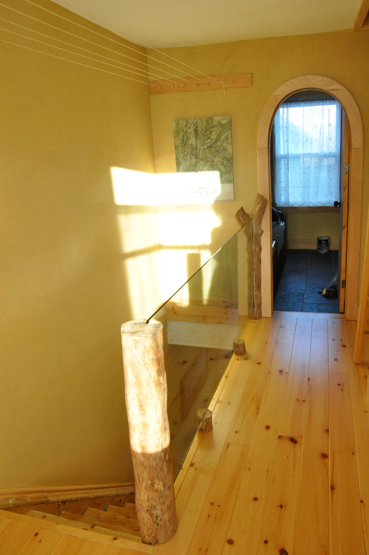 upstairs hall leading into lovely new renovated bathroom with soaker tub and stone sink