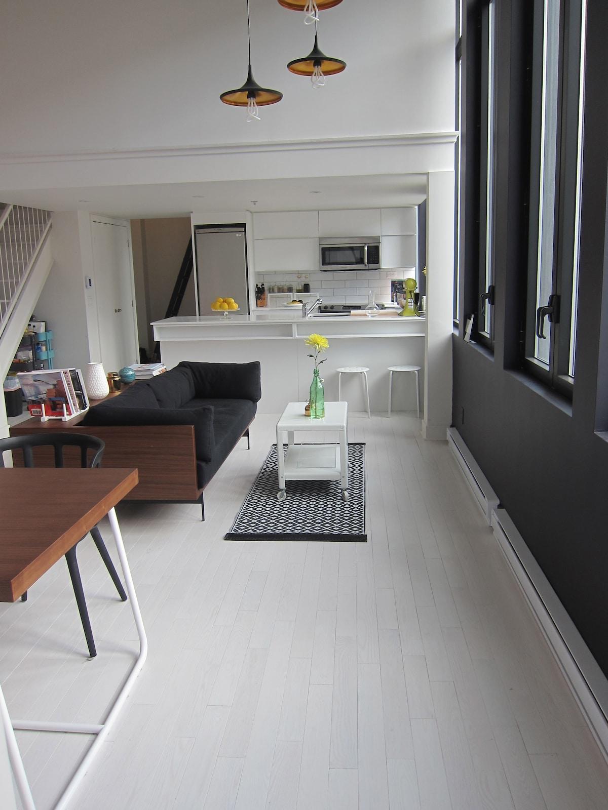 Open concept kitchen overlooking salon.