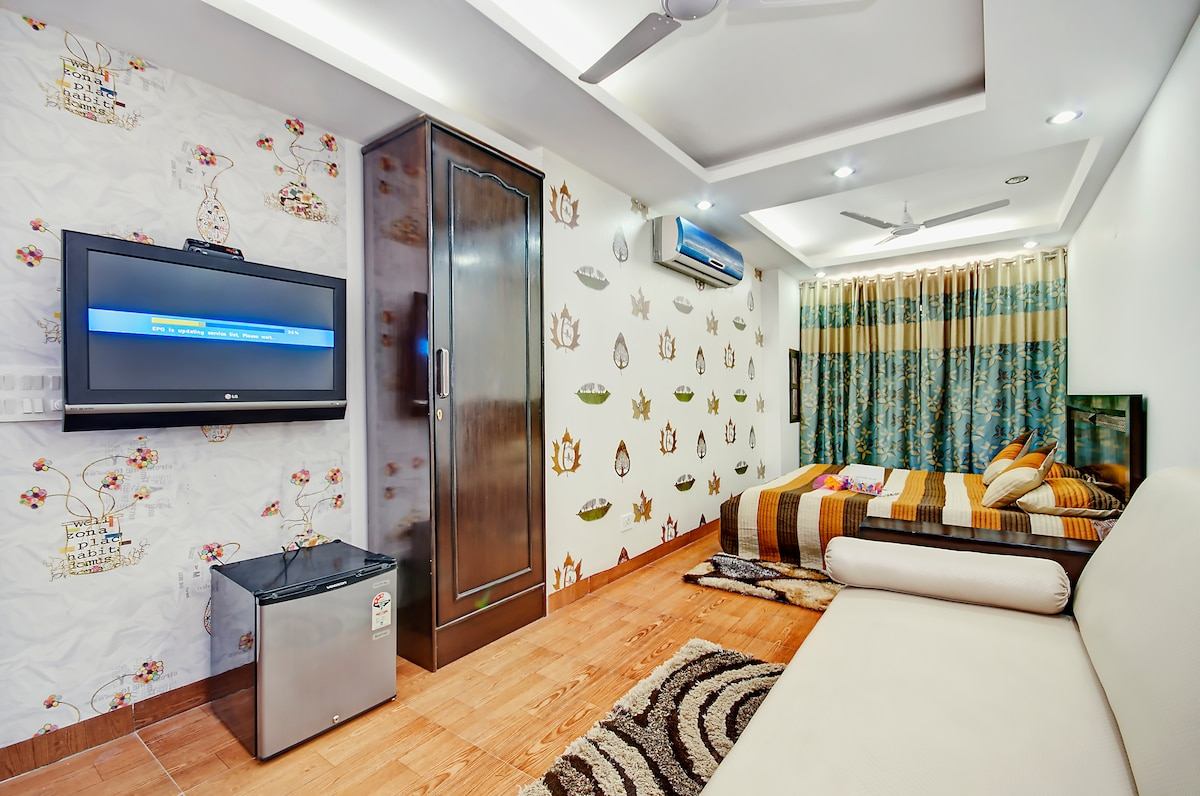 Tastefully decorated Studio. Beautiful colors are added through curtains and bed linens to add luxury.