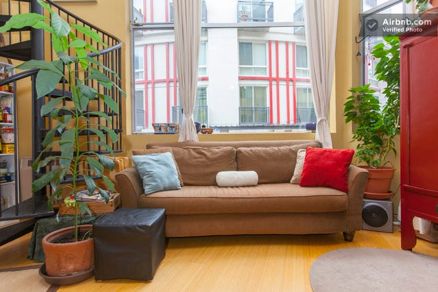 Couch in sunny, artistic loft