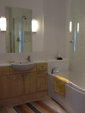 Private bathroom, clean, modern with shower, bath and WC.