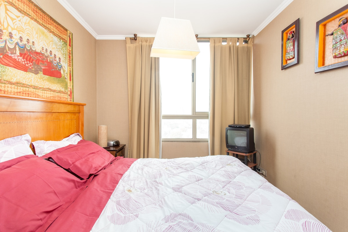 Double bed, bedside lamps, radio alarm clock, cable television and DVD player.