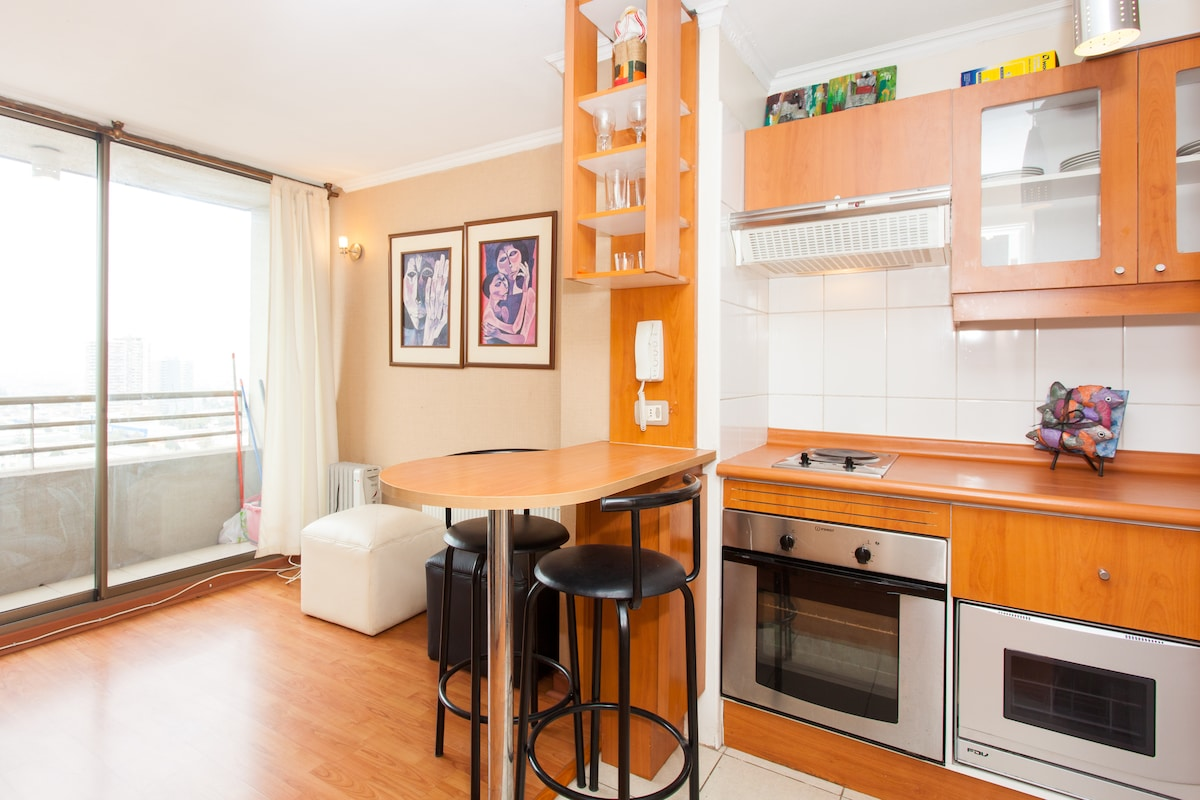 Fully-equipped kitchen, living room and a small balcony.