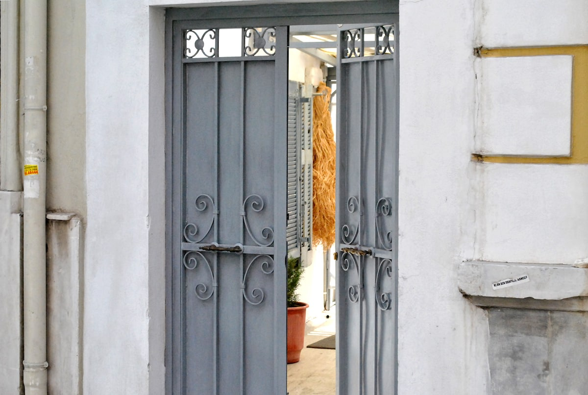 Private street entrance at the side of the main house