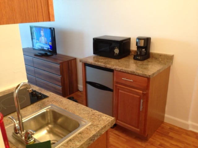 kitchen fully furnished + one large fridge on the lanai