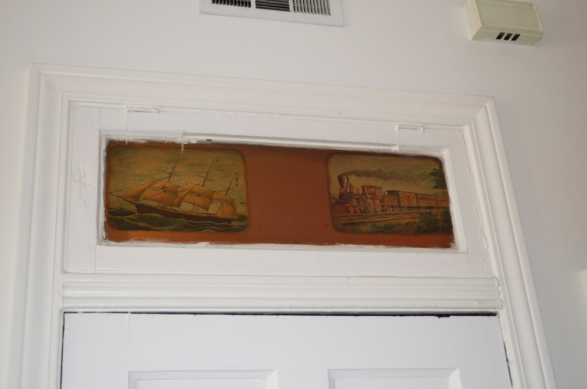 These paintings over the door to the apartment were here when I moved in.