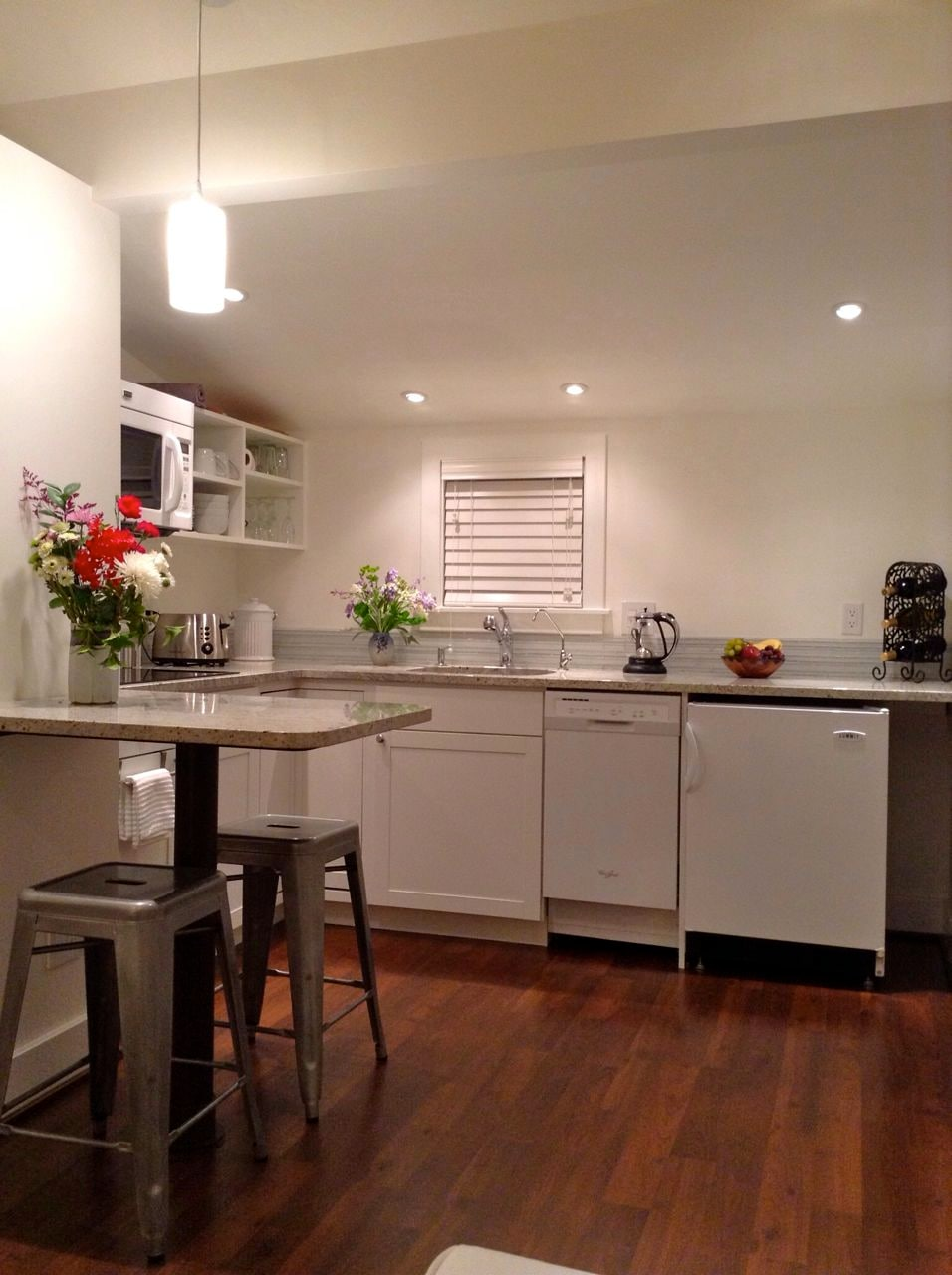 Kitchen: granite countertops, induction range, microwave/convection oven, dishwasher, refrigerator, filtered water.