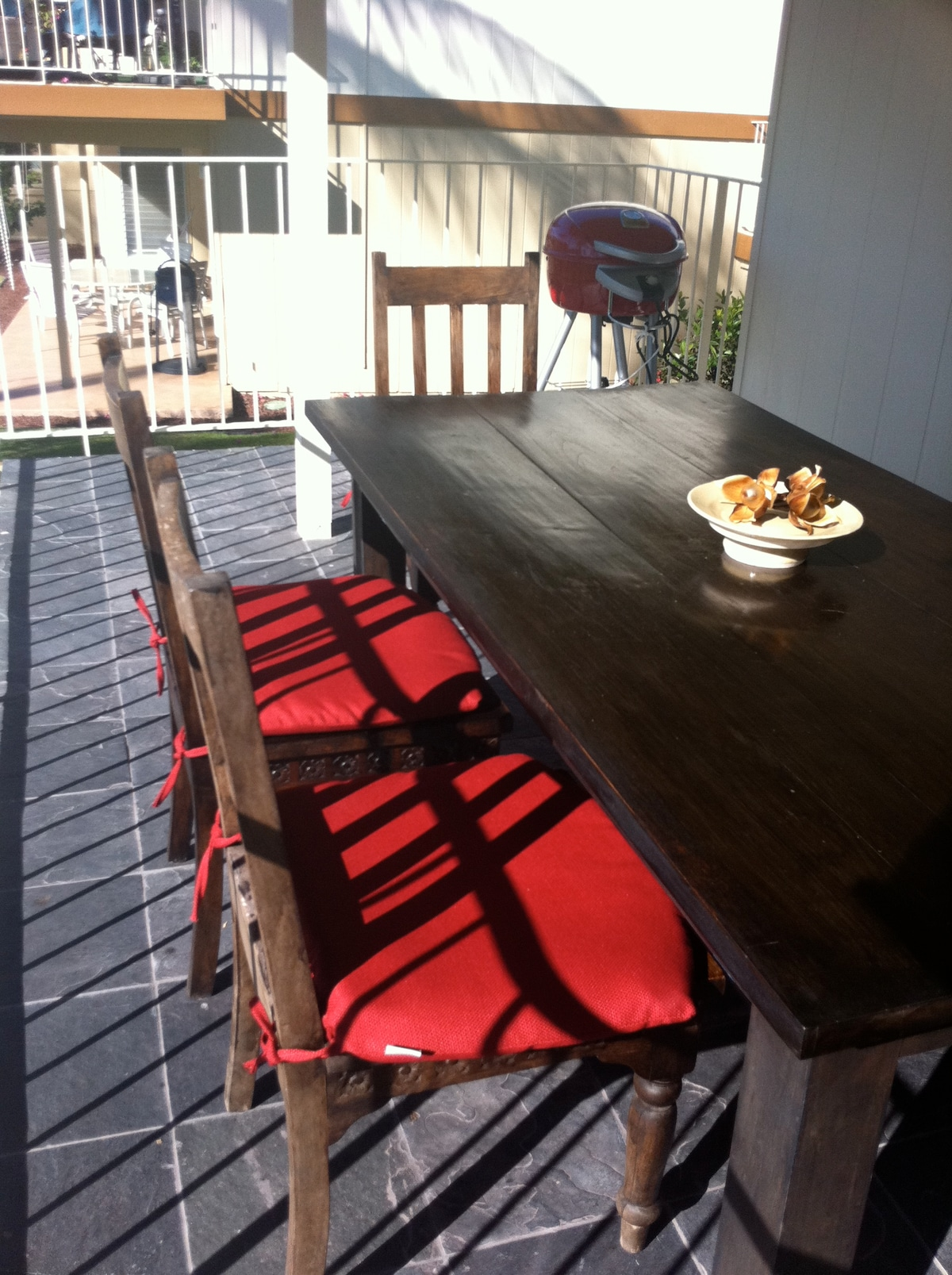 New electric grill with stone slate tile and teak dining table for six.