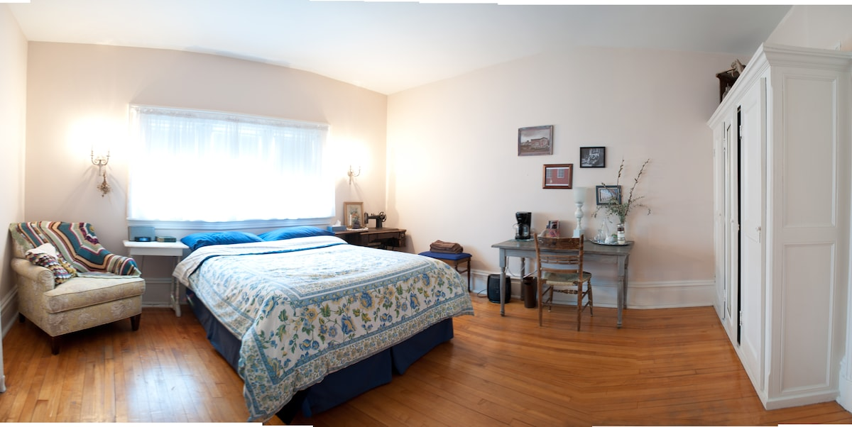 """The Navy"" Cozy and Quaint Bedroom appointed with queen bed and desk"