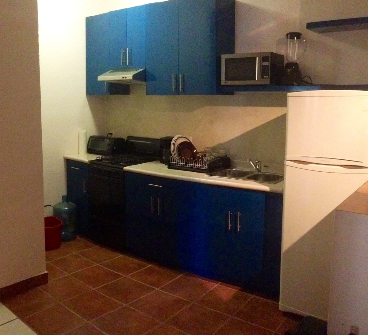 Good size kitchen with stove, microwave, blender, toaster oven, etc.