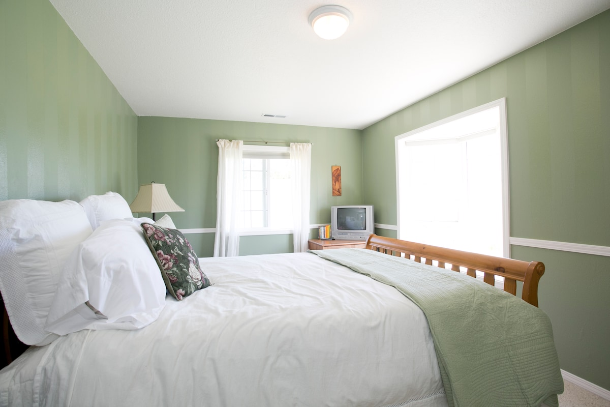 Claiming the best view in the house, our Vineyard View room has a queen bed, easy chair, and tv/dvd..