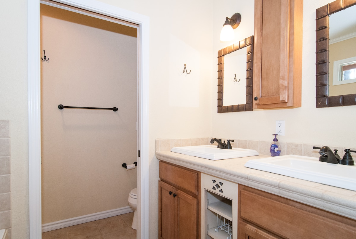 Master bathroom. Two separate sinks. Jacuzzi tub and separate shower.