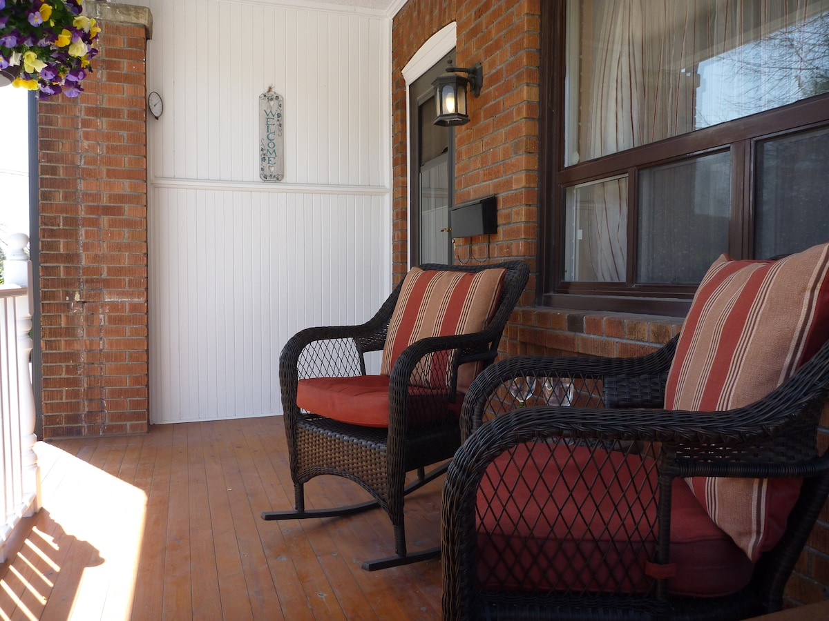 Front porch with seating area perfect for your morning coffee or an afternoon drink